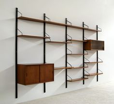 Royal Cado shelving unit. I have this many poles and many more unit pieces. teak vaneer. Not sure how to price it yet.
