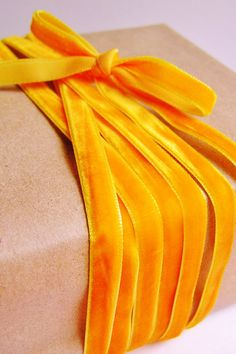 <3  Brown paper and marigold yellow velvet ribbon from the Gilded Bee