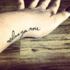 OMG I want this so bad....beautiful font beautiful placement and I know people should never get couple tats but me and Jare ALWAYS say I love you more lol!!