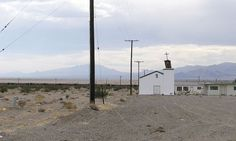 Amboy is a  ghost town in California's Mojave Desert, and the old church stands (rather lopsidedly) to prove it.