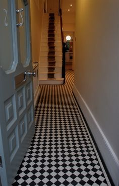 This Victorian style hallway is evident with the luxurious floor tiles, as well as the stripe on the staircase represents a red carpet which displays a luxurious lifestyle. Victorian Hallway Tiles, Tiled Hallway, White Hallway, Hallway Carpet, Hall Tiles, Hall Flooring, Flooring Ideas, Hallway Inspiration, Hallway Ideas