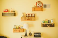 Vintage Suitcase Shelves with Travel Pieces from Around the World