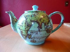 Two of my fave things-teapots and maps! Globe teapot.. Babs and Coco's Tea Emporium logo pot!