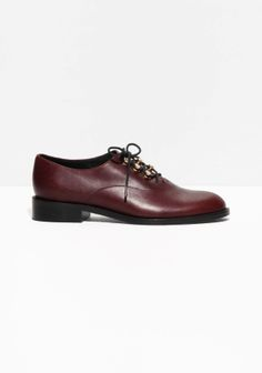 Leather flats with a to-be-laced front, featuring a stylish menswear look.