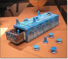 A Senet Board and Pieces.   Senet was a popular game among the ancient Egyptians  and is believed to be the oldest board game.