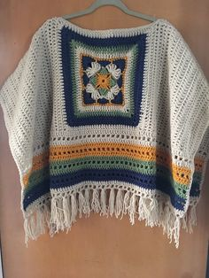 Crochet poncho with big granny square. Made to order, choose colors and sizes . Crochet poncho with big granny square. Made to order, choose colors and sizes … : Crochet poncho Crochet Jacket Pattern, Crochet Motifs, Granny Square Crochet Pattern, Crochet Squares, Crochet Shawl, Crochet Top, Crochet Patterns, Crochet Granny, Crochet Braid