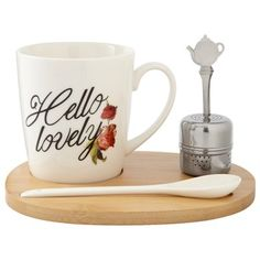 "The perfect cup is just a pour away with our new tea-lover's set. It comes with a generously sized cup, single-serve stainless steel infuser and ceramic stir spoon. Everything securely rests on a specially designed wood tray, making it perfect for work or school. The set comes beautifully boxed and makes an easy gift for any tea lover. Cup: 10 oz. capacity. 3.4"" diameter, 3.6"" tall. Ceramic mug and bamboo tray. Mug is dishwasher- and microwave-safe. Available only at Indigo."