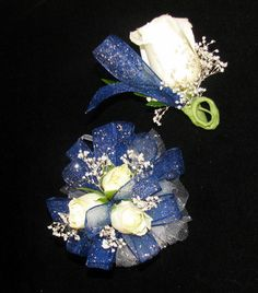 Navy Blue Corsage with matching Boutonniere.  Custom made for one of our clients.