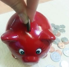 Placing coins into a piggy bank works on the important pincer grip, and also instills a sense of responsibility.