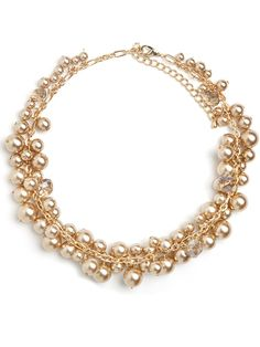 Champagne pearls get a modern update when strung in clusters and broken up by smoky glass beads.  Glass champagne pearls in varying sizes are strung in clusters on a gold-tone link chain, with glass topaz beads interspersed throughout.