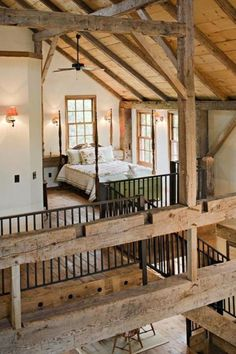 While this is apparently a cabin loft the wood beams would work well in a southwestern casa.  GORGEOUS beams.  Love the open loft.