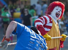 """Ronald McDonald joins in the struggle to move a large truck at the Ronald McDonald House Charities """"Pulling the House"""" event on Saturday, August 17, 2013.  