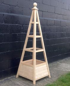 New Accoya Obelisk Planter - this sort of style would cover the conifer stump