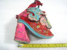 1850-90's, China, Lotus Shoes, for bound feet. -- Those poor, poor women.  (Well, poor rich women, since peasants couldn't afford to incapacitate half their work force.)