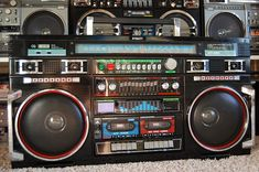 This is one of the famous Wheelie boomboxes, with woofers and roller wheels on the bottom. Use Case, Moving Pictures, Boombox, Sound Of Music, Jukebox, Backpack Bags, Techno, Tables, Audio