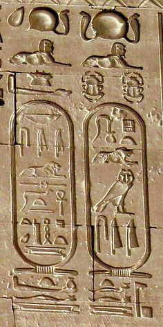 Cartouches of Caesarion in Dendera Temple, Egypt.  In archaeology, it refers to an oval or oblong shape enclosing Egyptian hieroglyphics that typically express divine or royal names.