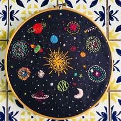 / outer space / colorful, embroidered design of the solar system / stitched desi. : / outer space / colorful, embroidered design of the solar system / stitched design of the sun, moon, stars and planets on black background / Hand Embroidery Stitches, Modern Embroidery, Embroidery Hoop Art, Cross Stitch Embroidery, Embroidery Designs, Art Graphique, Cross Stitching, Artsy, Outer Space