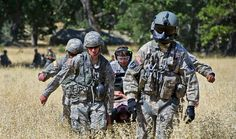 U.S. Army medical personnel carry a simulated patient to a UH-60 Black Hawk helicopter during an  aeromedical evacuation training exercise at Fort Hunter Liggett, Calif., June 19, 2012, in support of GLOBAL MEDIC 2012 and Warrior 91 12-01. GLOBAL MEDIC is a joint field training exercise for theater aeromedical evacuation systems and ground medical components designed to replicate all aspects of combat medical service support. Staff Sgt. Ashley Moreno