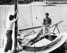 """circa 1946  John F. Kennedy and brother Edward M. Kennedy aboard """"Victura"""", Kennedy's sailboat, at Hyannis Port, Massachusetts. Photograph in the John F. Kennedy Presidential Library and Museum, Boston."""