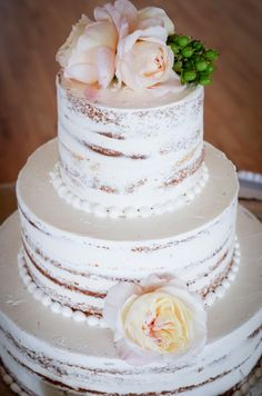 love naked wedding cakes! So romantic & simple! Mine will have peonies & baby's breath!