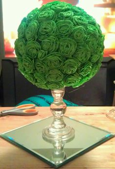 first test run for tissue/streamer rosette ball centerpiece. Everything purchased from Walmart. Streamers (2) $1 ea. Mirror $3. Candle holder $3. Foam ball $3. All you need for assembly is a glue gun and scissors and you've got a cheap diy $11 centerpiece.