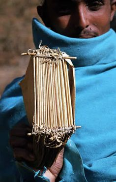 Book sections being carried to a bookbinder in Ethiopia. http://www.avparsons.com/scribes/binding.php