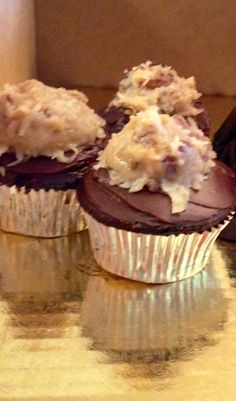 German chocolate cupcakes infused with chocolate liquor, topped with dark chocolate ganache and home made coconut pecan frosting.