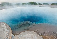 Groundwater heated to boiling goes up in steam at a geyser field northwest of Lake Abbe.