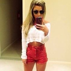 White top & red high waisted shorts