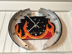 Brake shoe and license plate clock, decorated with hot rod flames.