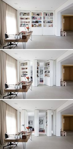 This modern home office has built-in white pivoting bookshelves that are also secret doors that can be opened to reveal a private living room.