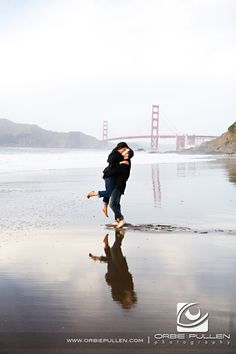 "LOVE the reflection in this one! ""Baker Beach Engagement and Wedding Photographer Orbie Pullen captured this photograph of a engaged couple in San Francisco, Ca."""