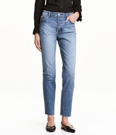 Check this out! CONSCIOUS. 5-pocket jeans in washed stretch denim with heavily distressed details. Regular waist, dropped gusset, button fly, and raw-edge hems. Cotton content is partly organic. - Visit hm.com to see more.