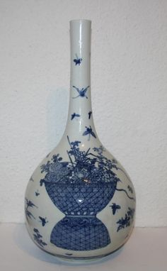 Description:  A Chinese blue and white bottle vase, in the Kangxi style (17th century) but later Qing Dynasty.    item's measurements:  Height: 43 cm    Item Date: 19th century.