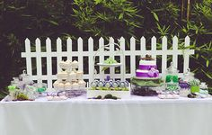 Secret Garden dessert display.  Love the use of the picket fencing.