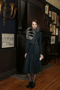 Fall 2013 Trend: Fine and Dandy (Band of Outsiders' wool blazer and skirt and fox-fur scarf, and Equipment's silk blouse. Carolina Amato gloves; Kushyfoot fishnets; Stuart Weitzman shoes.)