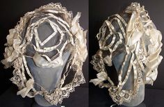 Civil War era snood headdress, 1860's. It is made of a wired frame covered with a delicate fine sheer brown net with white silk ribbon and lace trim edging draping down the back. There is white net surrounding the face, with white silk ribbon ruching bow trim accents. This breakfast coiffure cap has a snood style and would have been worn indoors during the morning. The cap measures 16 inches around the face opening.