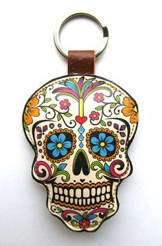 I love hanging things like this in the middle of your curtains as an accessory.  Leather keychain / bag charm  Sugar Skull by corrietovi on Etsy, $19.00
