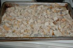 Place frozen chicken breasts straight onto a baking sheet and cook at 350 degrees for around 45 minutes, turning once.  Allow to cool in fridge.  Then place in a freezer bag with your favorite marinade.  Place on stove top at medium & heat through.
