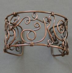 A copper wire bracelet by artist CraftyJules, on her Etsy page || Check out her web page on  http://www.craftyjules.com
