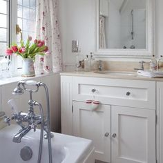 flower patterned accessories are another gorgeous way to liven up your small bathroom, like understated window treatments to keep the bathroom feeling feminine and romantic... Small Bathroom Chic: Lovely Floral Prints from Bathroom Bliss by Rotator Rod