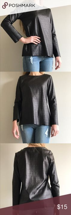 Faux leather black top Cute black faux leather top with small cut out pattern. Looks great with jeans. dylan Tops