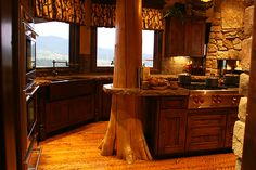 Rustic kitchen, love the tree