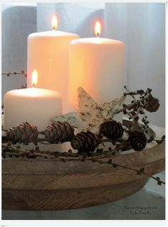 Candles and mini pine cones