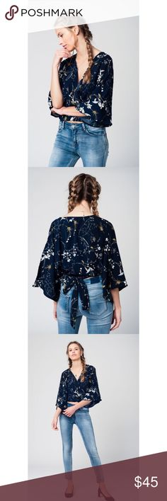 Navy Kimono Blouse w/ Leaves Print 100% Polyester Model is wearing size S.  Model is: 34-24-35. Height: 5'11''. Relaxed Fit. Tops Blouses