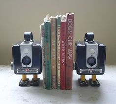 Now really I see cameras at the thrift stores and yard sales all of the time, dominoes too (or Dollar store) Legos as well, hot glue, or glue of your choice.... these twins are too cute.... little robots...