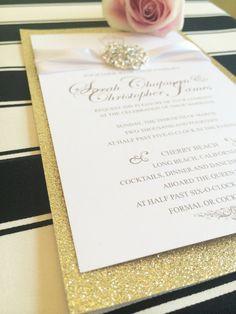 Gold Glitter Wedding Invitation With Jewel and White Silk Ribbon.