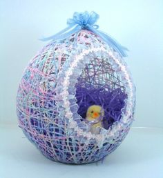 DIY Easter Basket with a balloon, string, liquid starch, tacky glue, ribbon & lace, and some Easter grass.