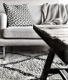 Livingroom, white couch, pattern pillow, wood table