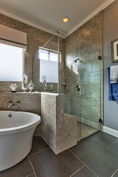 Transform your bathroom into a spa by the ocean with touches of beach decor and accents of blue.